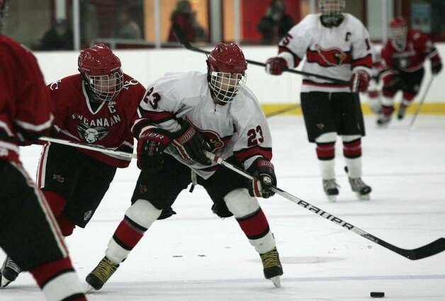 Greenwich High School's Matt Lodato, center, scored in the third period of Saturday's, Dec. 22, 2012, game against New Canaan.  New Canaan went on to win 4-2. Photo: DAVID AMES / GREENWICH TIME FREELANCE