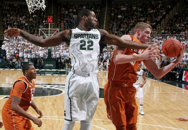 Michigan State's Branden Dawson (22) and Texas' Connor Lammert, right, reach for a rebound during the second half of an NCAA college basketball game, Saturday, Dec. 22, 2012, in East Lansing, Mich. Michigan State won 67-56. (AP Photo/Al Goldis) Photo: Al Goldis, Associated Press / FR11125 AP