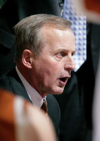 Texas coach Rick Barnes talks to his players during a timeout in the second half of an NCAA college basketball game against Michigan State, Saturday, Dec. 22, 2012, in East Lansing, Mich. Michigan State won 67-56. (AP Photo/Al Goldis) Photo: Al Goldis, Associated Press / FR11125 AP