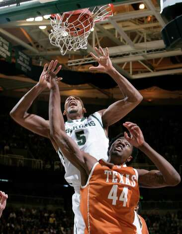 Michigan State's Adreian Payne (5) dunks over Texas' Prince Ibeh (44) during the second half of an NCAA college basketball game, Saturday, Dec. 22, 2012, in East Lansing, Mich. Michigan State won 67-56. (AP Photo/Al Goldis) Photo: Al Goldis, Associated Press / FR11125 AP