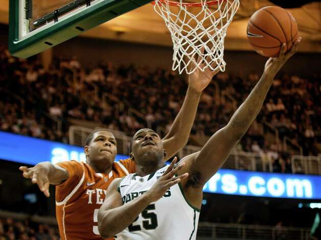 Michigan State's Derrick Nix (25) shoots a layup against Texas during an NCAA college basketball game Saturday, Dec. 22, 2012, in East Lansing, Mich. (AP Photo/Jackson Citizen Patriot, Mike Mulholland) LOCAL TV OUT  LOCAL INTERNET OUT Photo: Mike Mulholland, Associated Press / Jackson Citizen Patriot