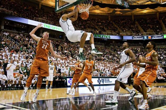 Michigan State's Keith Appling (5) dunks against Texas during an NCAA college basketball game Saturday, Dec. 22, 2012, in East Lansing, Mich. (AP Photo/Jackson Citizen Patriot, Mike Mulholland) LOCAL TV OUT  LOCAL INTERNET OUT Photo: Mike Mulholland, Associated Press / Jackson Citizen Patriot