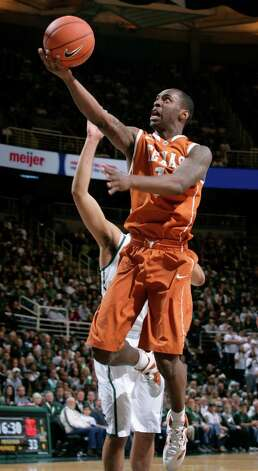 Texas' Sheldon McClellan puts up a shot during the second half of an NCAA college basketball game against Michigan State, Saturday, Dec. 22, 2012, in East Lansing, Mich. Michigan State won 67-56. (AP Photo/Al Goldis) Photo: Al Goldis, Associated Press / FR11125 AP