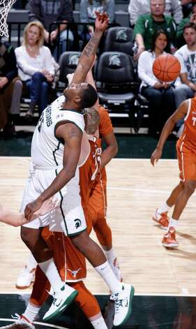 Michigan State's Derrick Nix, left, and Texas' Connor Lammert compete for a rebound during the first half of an NCAA college basketball game, Saturday, Dec. 22, 2012, in East Lansing, Mich. (AP Photo/Al Goldis) Photo: Al Goldis, Associated Press / FR11125 AP