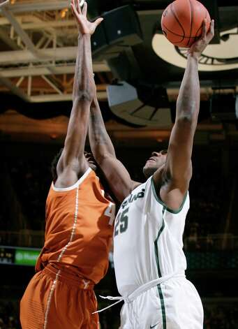 Michigan State's Derrick Nix (25) shoots against Texas' Prince Ibeh during the second half of an NCAA college basketball game, Saturday, Dec. 22, 2012, in East Lansing, Mich. Nix led Michigan State with 25 points and 11 rebounds in a 67-56 win. (AP Photo/Al Goldis) Photo: Al Goldis, Associated Press / FR11125 AP