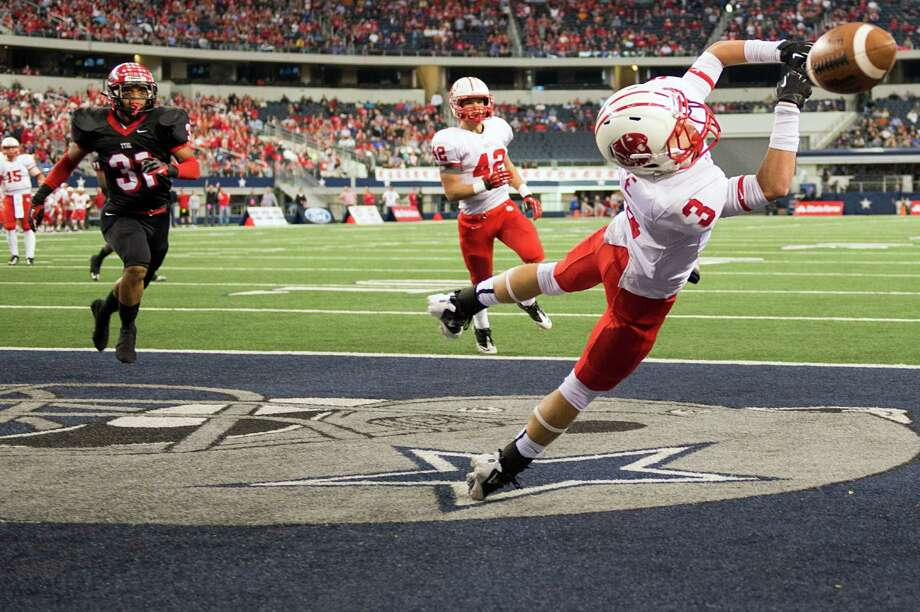 Katy wide receiver Logan Otte (3) can't catch a pass in the end zone as Cedar Hill defensive back Jonathan Buffin (31) defends during the first half of the Class 5A Division II state championship football game at Cowboys Stadium on Saturday, Dec. 22, 2012, in Arlington. Photo: Smiley N. Pool, Houston Chronicle / © 2012  Houston Chronicle