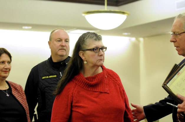 LuAnn Burgess, center, the 55-year-old Voorheesville woman accused of killing three people with her runaway SUV, at Albany County Court in Albany, NY Friday Nov. 9, 2012. (Michael P. Farrell/Times Union) Photo: Michael P. Farrell / 00020040A