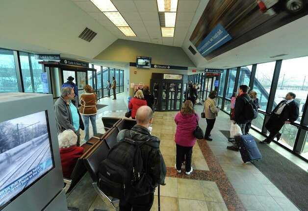 Holiday travelers at the Amtrak station in Rensselaer, N.Y., Saturday Dec. 22 2012. (Michael P. Farrell/Times Union) Photo: Michael P. Farrell