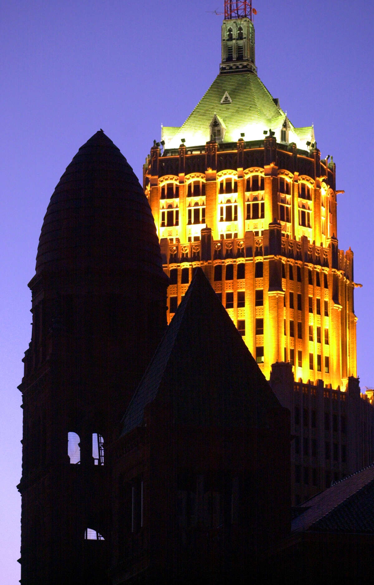 Contrasts in architectural styles in San Antonio can be seen in the Bexar County Courthouse (foreground) and the Tower Life Building (rear).