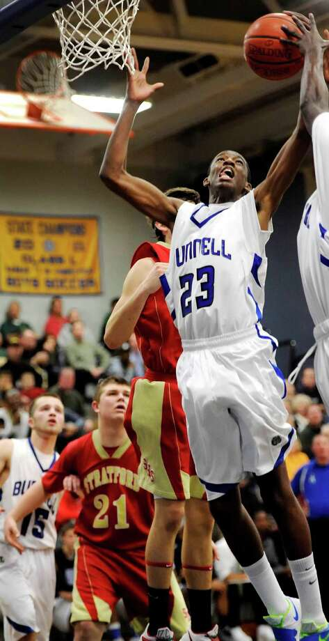 Bunnell high school's Issac Vann goes up for a rebound in a boys basketball game against Stratford high school played at Bunnell high school, Stratford, CT on Saturday, December 22nd, 2012. Photo: Mark Conrad / Connecticut Post Freelance