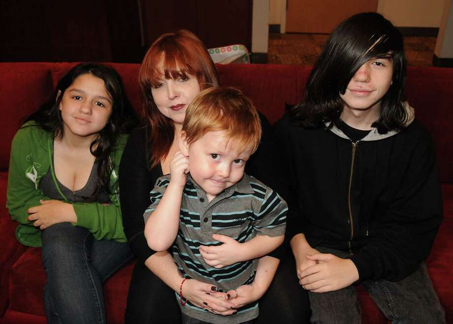 From left: Zoe, her mom, Stacy, Peter and Logan Hart attend a recent Christmas party for Goodfellows families. Photo: Dave Rossman, Freelance / © 2012 Dave Rossman