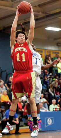 Stratford high school's Nick DiIulio pulls down a rebound in a boys basketball game against Bunnell high school played at Bunnell high school, Stratford, CT on Saturday, December 22nd, 2012. Photo: Mark Conrad / Connecticut Post Freelance