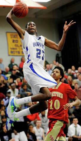 Bunnell high school's Issac Vann goes up to dunk the ball in a boys basketball game against Stratford high school played at Bunnell high school, Stratford, CT on Saturday, December 22nd, 2012. Photo: Mark Conrad / Connecticut Post Freelance