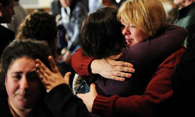NEWTOWN, CT - DECEMBER 16:  Mourners comfort one another before U.S. President Barack Obama speaks at an interfaith vigil for the shooting victims from Sandy Hook Elementary School on December 16, 2012 at Newtown High School in Newtown, Connecticut. Twenty-six people were shot dead, including twenty children, after a gunman identified as Adam Lanza opened fire at Sandy Hook Elementary School. Lanza also reportedly had committed suicide at the scene. A 28th person, believed to be Nancy Lanza, found dead in a house in town, was also believed to have been shot by Adam Lanza. (Photo by Olivier Douliery-Pool/Getty Images) Photo: Pool, Getty Images / 2012 Getty Images