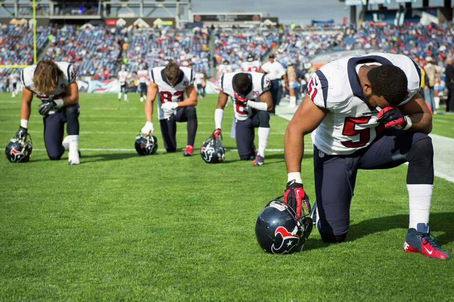 Before any Sunday's mayhem on the field, many NFL players - like Texans inside linebacker Darryl Sharpton (51) and three teammates - take a moment for prayer. Photo: Smiley N. Pool, Staff / © 2012  Houston Chronicle