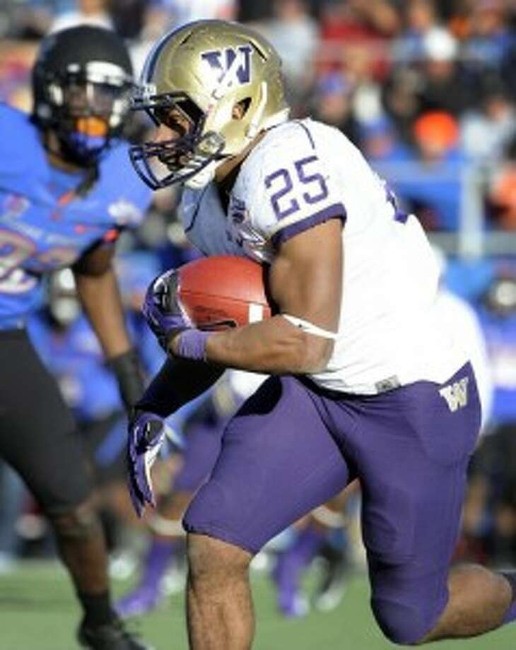 UW running back Bishop Sankey takes the ball during the second half Saturday. (David Becker/AP Photo)