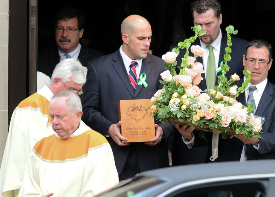 The ashes of Mary Joy Sherlach are carried from St. Stephen Church, in Trumbull, Conn., following a funeral mass Dec. 21st, 2012. Sherlach was a school pychologist at Sandy Hook Elementary School, in Newtown, and died in the mass shooting there last Friday. Photo: Ned Gerard / Connecticut Post