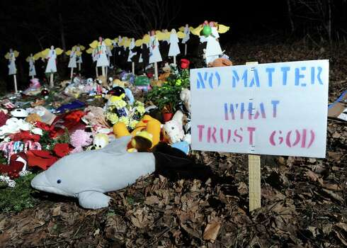 "A sign on the side of Church Hill Road reads ""No Matter What, Trust God,"" at a memorial to the victims of the Sandy Hook Elementary School massacre, in Newtown, Conn., Saturday, Dec. 22, 2012. Photo: Bob Luckey / Greenwich Time"