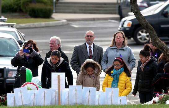 Mourners look at a memorial before the funeral for Josephine Gay at  St. Rose of Lima Roman Catholic Church, Saturday, Dec. 22, 2012, in Newtown. Gay was one of 26 killed after gunman Adam Lanza opened fire killing 26 individuals, 20 whom were children, at Sandy Hook Elementary School last Friday. Photo: Cody Duty, Cody Duty/Hearst Newspapers / The News-Times