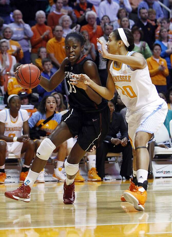 Stanford's Chiney Ogwumike (left) drives against Tennessee's Isabelle Harrison in the first half. Photo: Wade Payne, Associated Press