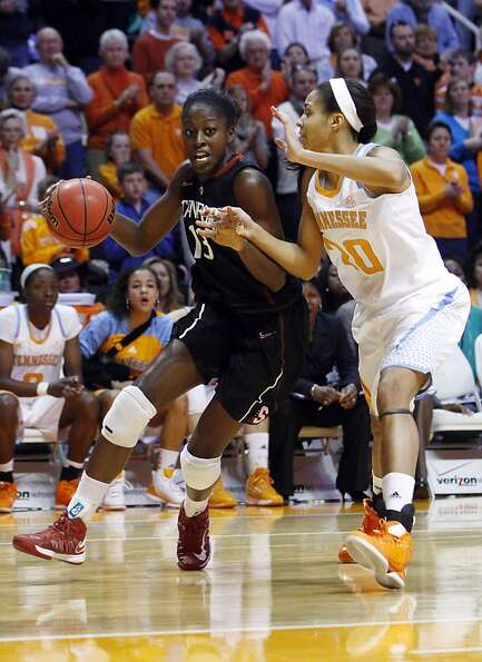 Stanford forward Chiney Ogwumike (13) drives against Tennessee center Isabelle Harrison (20) in the