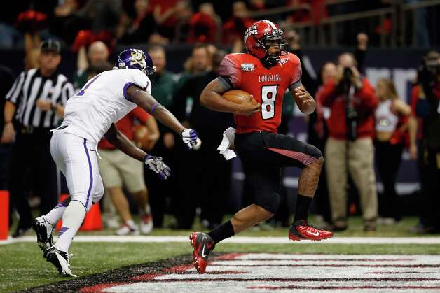 R+L Carriers New Orleans Bowl, Dec. 22: Louisiana-Lafayette 43, East Carolina 34; Mercedes-Benz Superdome in New Orleans; Payout: $500,000 PHOTO: Louisiana-Lafayette's Terrance Broadway scores a touchdown as East Carolina's Chip Thompson trails during the R+L Carriers New Orleans Bowl. Photo: Chris Graythen, Getty Images / 2012 Getty Images