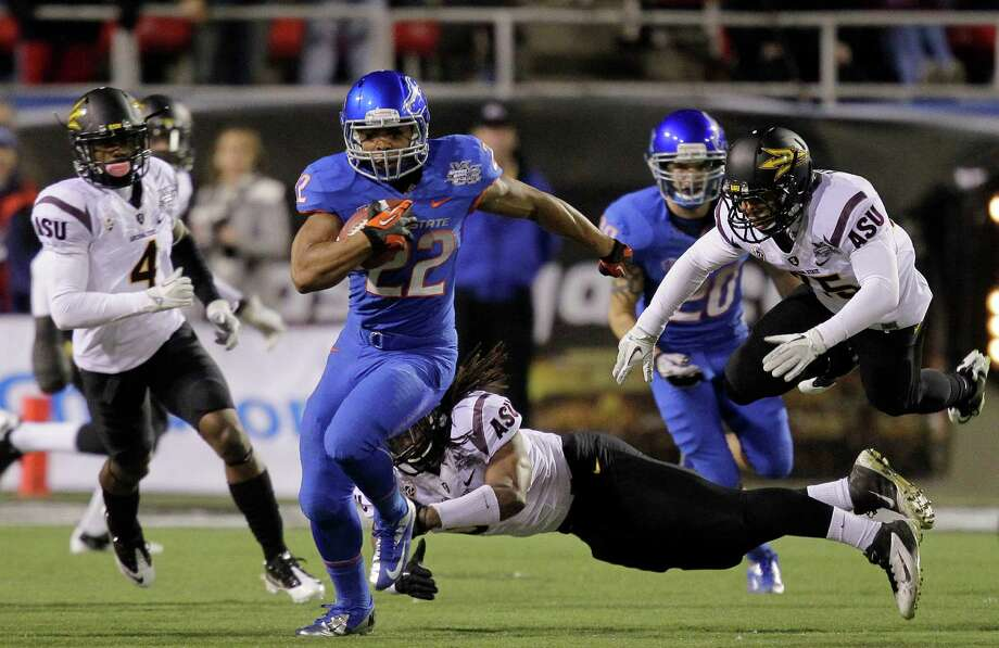 MAACO Las Vegas Bowl, Dec. 22: Boise State 28, Washington 26; Sam Boyd Stadium in Las Vegas; Payout: $1,100,000 PHOTO: Boise State running back Doug Martin breaks free from the Arizona State defense to run the opening kickoff back for a touchdown during the MAACO Las Vegas Bowl. Photo: Julie Jacobson, Associated Press / AP