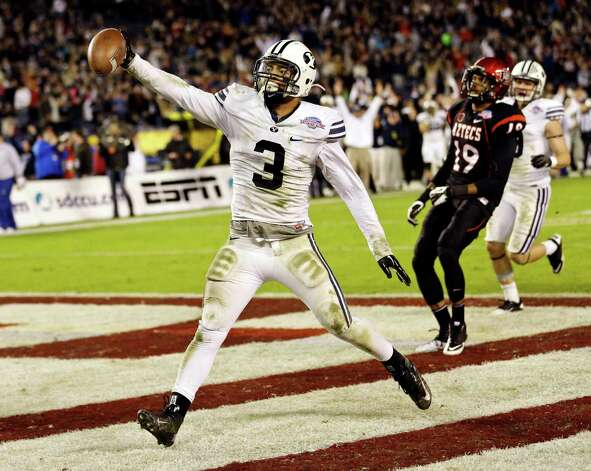 S.D. County Credit Union Poinsettia Bowl, Dec. 20: BYU 23, San Diego State 6; Qualcomm Stadium in San Diego, Calif.; Payout: $500,000 PHOTO: BYU linebacker Kyle Van Noy holds out the ball as he scores on a 17-yard interception return during the fourth quarter of the Poinsettia Bowl. Photo: Lenny Ignelzi, Associated Press / AP
