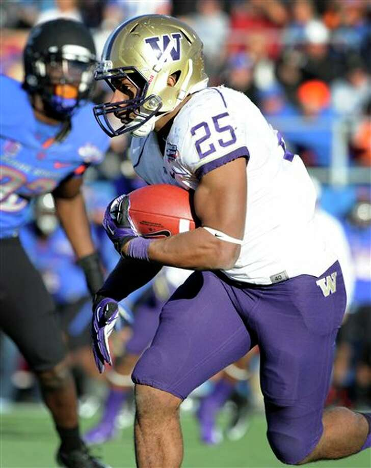 Washington tailback Bishop Sankey (25) runs with the ball during second half of the MAACO Bowl NCAA college football game against Boise State, Saturday, Dec. 22, 2012, in Las Vegas. Sankey was awarded the MVP of the game. Photo: David Becker, AP / FR170737 AP