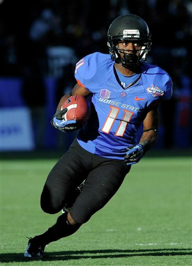 Boise State wide receiver Shane Williams-Rhodes (11) runs with the ball during the second half of the MAACO Bowl NCAA college football game against Washington, Saturday, Dec. 22, 2012, in Las Vegas. Boise State won 28-26. Photo: David Becker, AP / FR170737 AP