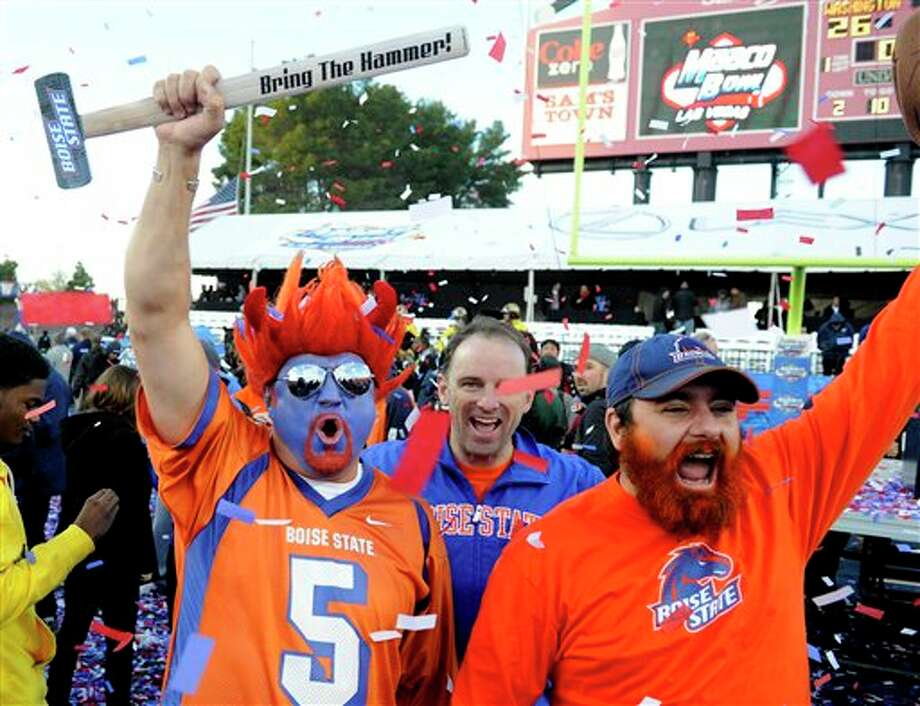 Boise State fans celebrate after their team's victory over Washington in the MAACO Bowl NCAA college football game on Saturday, Dec. 22, 2012, in Las Vegas. Boise State won 28-26. Photo: David Becker, AP / FR170737 AP
