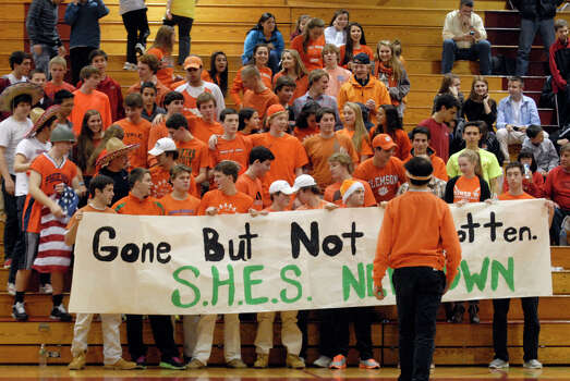 Greenwich fans wear orange as a sign of dedication to GHS student Nicole Graham and also demonstrate their support for the families in Newtown as Greenwich High School hosts  Fairfield Ludlowe in a boys basketball game in Greenwich, Conn., Dec. 21, 2012. Graham was diagnosed with Leukemia in September. Photo: Keelin Daly / Stamford Advocate Riverbend Stamford, CT