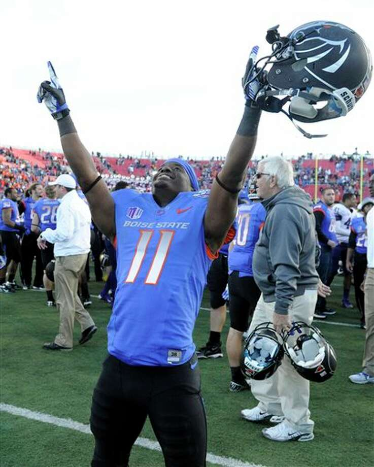 Boise State wide receiver Shane Williams-Rhodes (11) celebrates after his team won the MAACO Bowl NCAA college football game against Washington, Saturday, Dec. 22, 2012, in Las Vegas. Boise State won 28-26. Photo: David Becker, AP / FR170737 AP