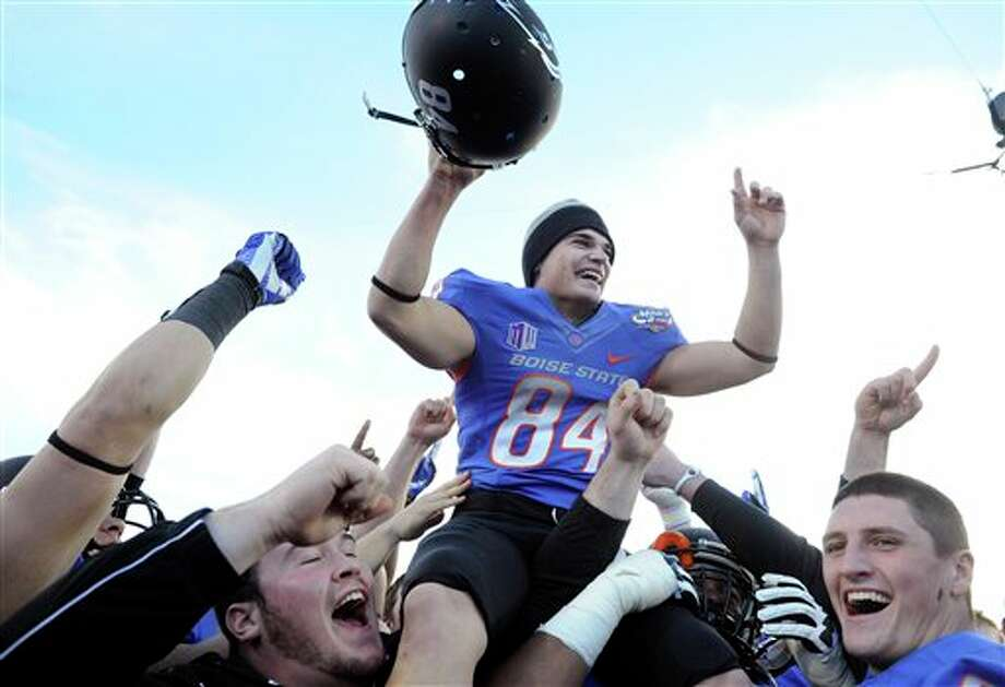 Boise State kicker Michael Frisina (84) celebrates after his team defeated Washington at the MAACO Bowl NCAA college football game on Saturday, Dec. 22, 2012, in Las Vegas. Frisina kicked the go-ahead field goal in the fourth quarter for a 28-26 final. Photo: David Becker, AP / FR170737 AP