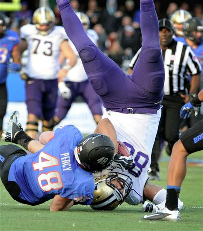 Washington tight end Austin Seferian-Jenkins (88) is upended as he makes a reception with Boise State's J.C. Percy (48) defending during the second half of the MAACO Bowl NCAA college football game on Saturday, Dec. 22, 2012, in Las Vegas. Boise State won 28-26. Photo: David Becker, AP / FR170737 AP