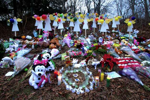 A memorial site  is seen Thursday, December 20, 2012 in Newtown, Conn., honoring the individuals who were killed during a shooting at Sandy Hook Elementary School last Friday. The school was evacuated after Adam Lanza opened fire killing 26 individuals, 20 whom were children. Photo: Cody Duty, Cody Duty/Hearst Newspapers / The News Times