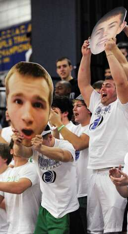 Bunnell high school fans cheer on their team and hold up coutouts of two Bunnell players in a boys basketball game against Stratford high school played at Bunnell high school, Stratford, CT on Saturday, December 22nd, 2012. Photo: Mark Conrad / Connecticut Post Freelance