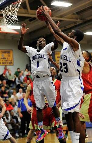 Bunnell high school's Ryan Pittman (1) and Issac Vann (23) go up for a rebound in a boys basketball game against Stratford high school played at Bunnell high school, Stratford, CT on Saturday, December 22nd, 2012. Photo: Mark Conrad / Connecticut Post Freelance
