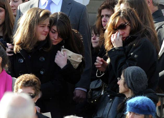 Mourners exit St. Mary Of The Assumption Church in Katonah, N.Y. after the funeral for Anne Marie Murphy on Thursday, Dec. 20, 2012.  Murphy was killed when Adam Lanza, walked into Sandy Hook Elementary School in Newtown, Conn., Dec. 14, and opened fire, killing 26, including 20 children, before killing himself. (AP Photo/The Stamford Advocate, Lindsay Niegelberg) MANDATORY CREDIT Photo: Lindsay Niegelberg, Associated Press / Connecticut Post