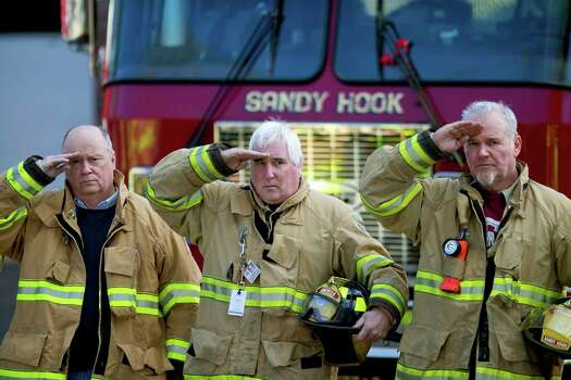 Firefighters salute as a hearse passes for the funeral procession to the burial of 7-year-old Sandy Hook Elementary School shooting victim Daniel Gerard Barden, Wednesday, Dec. 19, 2012, in Newtown, Conn. Barden was killed when Adam Lanza walked into Sandy Hook Elementary School in Newtown, Conn., Dec. 14, and opened fire, killing 26 people, including 20 children, before killing himself.(AP Photo/David Goldman) Photo: David Goldman, Associated Press / Associated Press