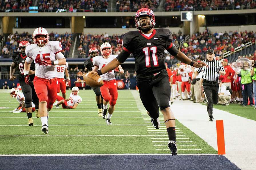 Cedar Hill quarterback Damion Hobbs (11) scores on a fourth down play against Katy during the second