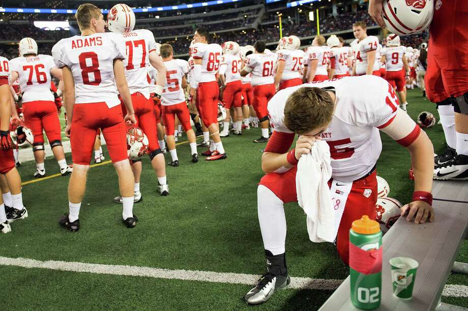 Katy quarterback Kiley Huddleston (15) kneels in prayer on the sidelines during the closing moments of the second half of a victory over Cedar Hill in the Class 5A Division II state championship football game at Cowboys Stadium on Saturday, Dec. 22, 2012, in Arlington. Photo: Smiley N. Pool, Houston Chronicle / © 2012  Houston Chronicle