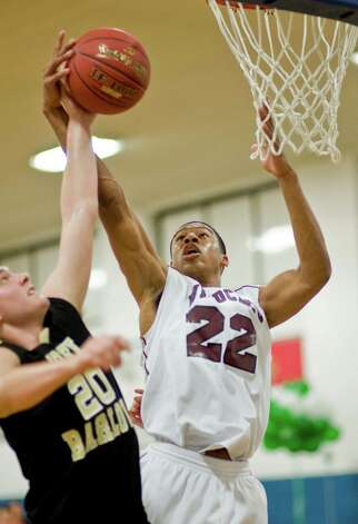 Bethel High School's Daniel Garvin goes up for a shot during the championship game of the Tip-Off Classic boys basketball tournament against Joel Barlow High School, played at the War Memorial in Danbury. Saturday, Dec. 22, 2012 Photo: Scott Mullin / The News-Times Freelance