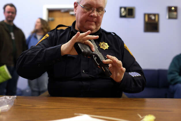 BRIDGEPORT, CT - DECEMBER 22:  Lt. Ray Mesek registers a pistol at a gun buyback event at the Bridgeport Police Department's Community Services Division on December 22, 2012 in Bridgeport, Connecticut. The buyback program, the largest in the city's history, will offer up to $200 value for a working handgun, $75 for a rifle and a higher rate of payment for a weapon determined to be an assault-type rifle. There was strong turnout for the event with many residents turning in guns they haven't used in years. Following the massacre of children and adults at a school in Newtown, Connecticut last week, numerous Connecticut towns and cities are trying to get more guns off the street. Photo: Spencer Platt, Getty Images / 2012 Getty Images