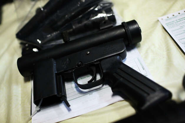 BRIDGEPORT, CT - DECEMBER 22:  A pistol that has been turned in at a gun buyback event are viewed at the Bridgeport Police Department's Community Services Division on December 22, 2012 in Bridgeport, Connecticut. The buyback program, the largest in the city's history, will offer up to $200 value for a working handgun, $75 for a rifle and a higher rate of payment for a weapon determined to be an assault-type rifle. There was strong turnout for the event with many residents turning in guns they haven't used in years. Following the massacre of children and adults at a school in Newtown, Connecticut last week, numerous Connecticut towns and cities are trying to get more guns off the street. Photo: Spencer Platt, Getty Images / 2012 Getty Images