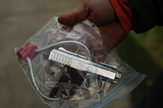 BRIDGEPORT, CT - DECEMBER 22:  A man waits to turn in a pistol at a gun buyback event at the Bridgeport Police Department's Community Services Division on December 22, 2012 in Bridgeport, Connecticut. The buyback program, the largest in the city's history, will offer up to $200 value for a working handgun, $75 for a rifle and a higher rate of payment for a weapon determined to be an assault-type rifle. There was strong turnout for the event with many residents turning in guns they haven't used in years. Following the massacre of children and adults at a school in Newtown, Connecticut last week, numerous Connecticut towns and cities are trying to get more guns off the street. Photo: Spencer Platt, Getty Images / 2012 Getty Images