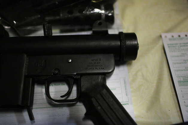 BRIDGEPORT, CT - DECEMBER 21: A pistol that has been turned in at a gun buyback event are viewed at the Bridgeport Police Department's Community Services Division on December 22, 2012 in Bridgeport, Connecticut. The buyback program, the largest in the city's history, will offer up to $200 value for a working handgun, $75 for a rifle and a higher rate of payment for a weapon determined to be an assault-type rifle. There was strong turnout for the event with many residents turning in guns they haven't used in years. Following the massacre of children and adults at a school in Newtown, Connecticut last week, numerous Connecticut towns and cities are trying to get more guns off the street. Photo: Spencer Platt, Getty Images / 2012 Getty Images