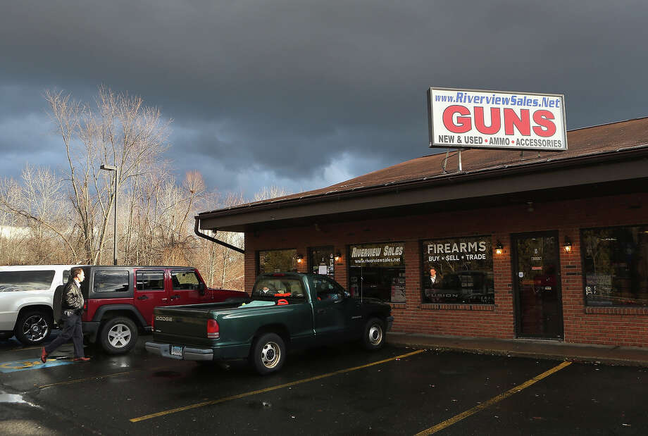 A customer approaches the closed Riverview Gun Sales shop on December 21, 2012 in East Windsor, Connecticut. According to the Hartford Courant, sources investigating the massacre at the Sandy Hook Elementary School in Newtown have said the Bushmaster rifle used by the gunman Adam Lanza was legally purchased at the shop by his mother Nancy Lanza. The Courant also reports that records show the guns used in a previous mass shooting in Connecticut in 2010, where Omar Thornton killed eight people and himself at Hartford Distributers Inc, were also purchased at Riverview Gun Sales. On Thursday agents from the federal Bureau of Alcohol, Tobacco, Firearms and Explosives (ATF), and local police raided and closed the gun shop. Photo: John Moore, Getty Images / 2012 Getty Images