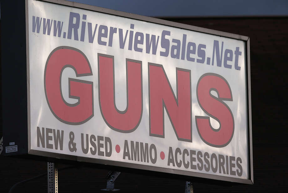 A sign sits atop the closed Riverview Gun Sales shop on December 21, 2012 in East Windsor, Connecticut. According to the Hartford Courant, sources investigating the massacre at the Sandy Hook Elementary School in Newtown have said the Bushmaster rifle used by the gunman Adam Lanza was legally purchased at the shop by his mother Nancy Lanza. The Courant also reports that records show the guns used in a previous mass shooting in Connecticut in 2010, where Omar Thornton killed eight people and himself at Hartford Distributers Inc, were also purchased at Riverview Gun Sales. On Thursday agents from the federal Bureau of Alcohol, Tobacco, Firearms and Explosives (ATF), and local police raided and closed the gun shop. Photo: John Moore, Getty Images / 2012 Getty Images