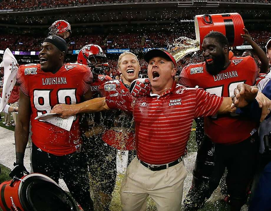 NEW ORLEANS, LA - DECEMBER 22:  Head coach Mark Hudspeth of the Louisiana-Lafayette Ragin Cajuns is dunked with sports drink after defeating the East Carolina Pirates during the R+L Carriers New Orleans Bow at the Mercedes-Benz Superdome on December 22, 2012 in New Orleans, Louisiana.  (Photo by Chris Graythen/Getty Images) Photo: Chris Graythen, Getty Images